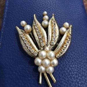 Rhinestones and gold pearl pin